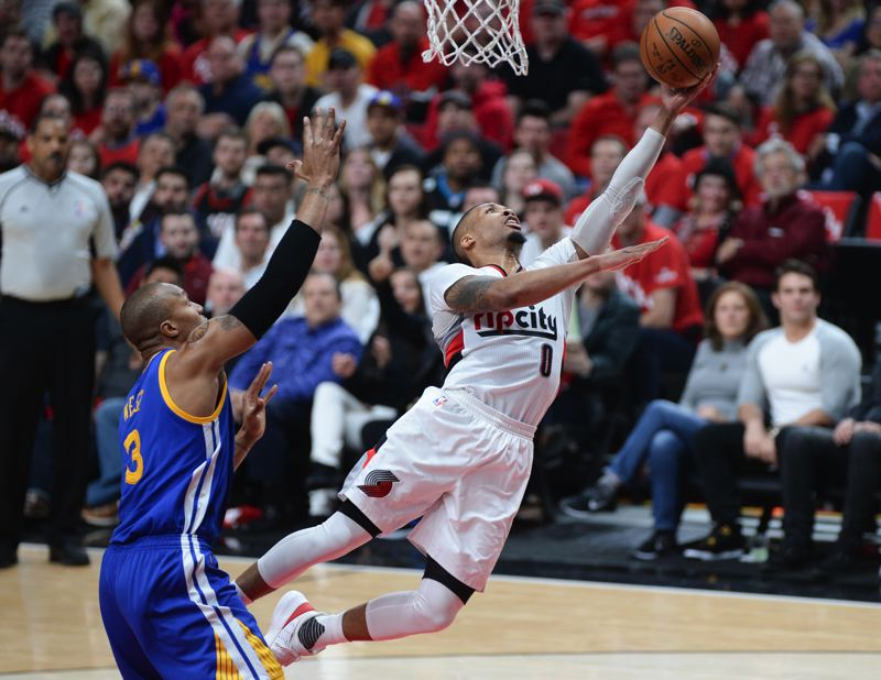 TRIBUNE PHOTO: JOSH KULLA - Trail Blazers guard Damian Lillard lays out for a layup.