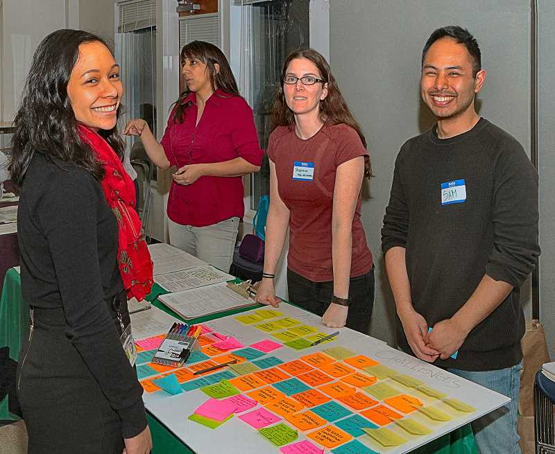 DAVID F. ASHTON - Jena Hughes, from the City of Portland Bureau of Planning & Sustainability, learned about a community engagement and action plan for BDNA from Portland State University students Shannon Williams and Samuel Garcia.