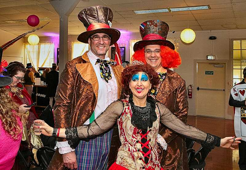 DAVID F. ASHTON - Mad Hatters T.J. Slansky and Jason Mullenix pause for a picture with the Red Queen, Jennifer Slansky.