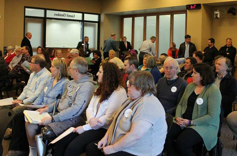 SPOKESMAN PHOTO: CLAIRE GREEN - Wilsonville City staff had to bring in more chairs multiple times to be able to seat the large crowd at the April 20 meeting.