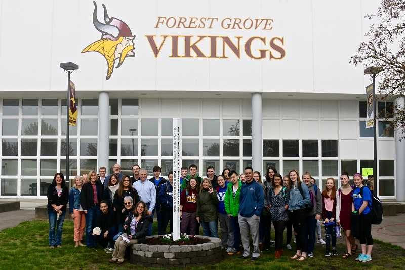 COURTESY PHOTO: JAMES MOORE - Community members, school staff and students gathered Friday morning for a dedication of the new Peace Pole at Forest Grove High School.
