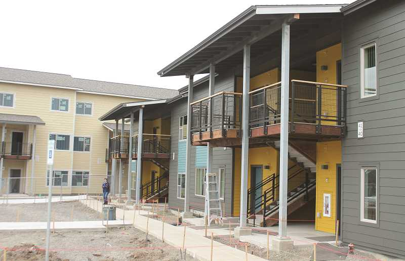 PIONEER PHOTO: CONNER WILLIAMS - Construction of 27 new apartment units and 20 remodeled units is nearing completion for the Molalla Gardens, the Catholic Charties' housing for low-income families. The apartment complex is located at the corner of Fenton and Heintz streets in downtown Molalla.