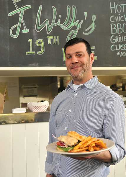 STAFF PHOTOS:VERN UYETAKE   - Bob Whitely is the manager and cook at the 19th Hole, the cafe at the Lake Oswego Golf Course. The cafe will serve a variety of popular sandwiches and snacks. It has a full bar and serves draft and bottled beer and wines.