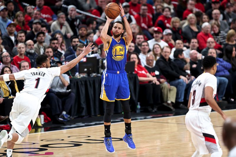 TIMES PHOTO: JAIME VALDEZ - In Game 4, Curry lit up Portland (again) and helped knock the Blazers out of the title hunt (again) before meeting with his extended family, the Brinks, of Beaverton.