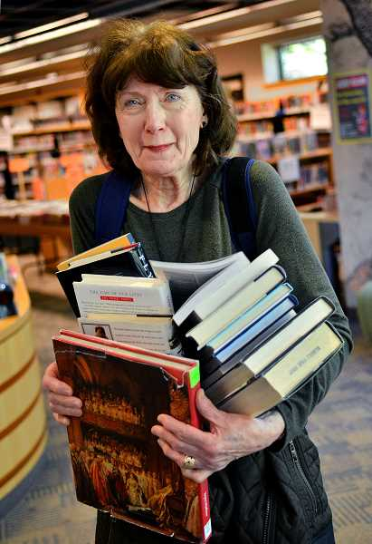 Darleen Deasee has an arm full of books she found.