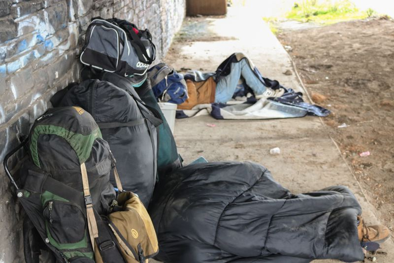 OUTLOOK PHOTO: ZANE SPARLING - A homeless man underneath the Interstate 84 overpass near Troutdale.