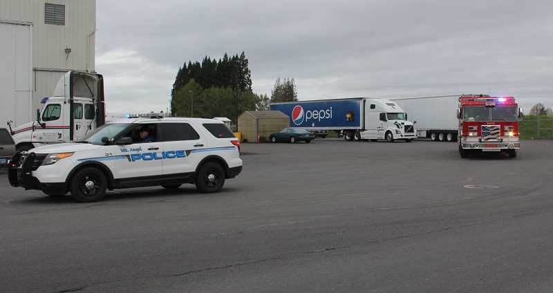 LINDSAY KEEFER - Mount Angel Police and Mount Angel Fire escorted the Pepsi Rolling Remembrance tractor trailer as it rode out of town on its next stop in an 8,000-mile relay across the country to raise awareness for a foundation that supports fallen heroes' children.