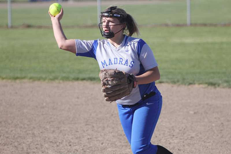 WILL DENNER/MADRAS PIONEER - Madras second baseman Kianna Moschetti throws to first base during a game against Crook County Friday.