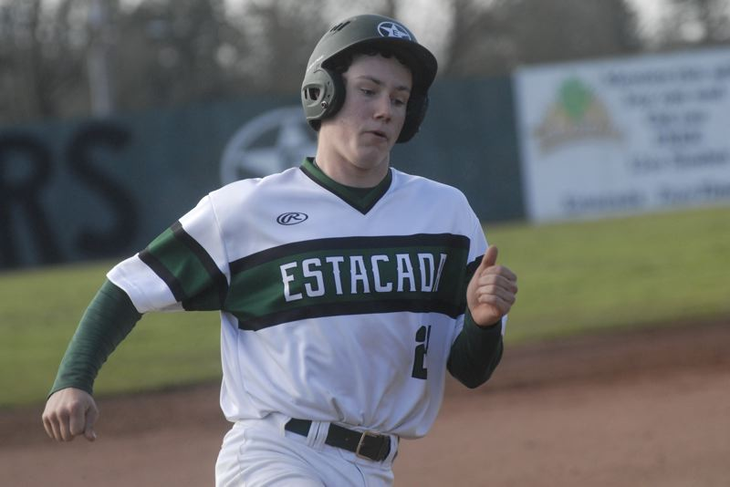 ESTACADA NEWS: MATT RAWLINGS - Kodey James rounds third and heads for home in Estacada's 4-2 win over Gladstone