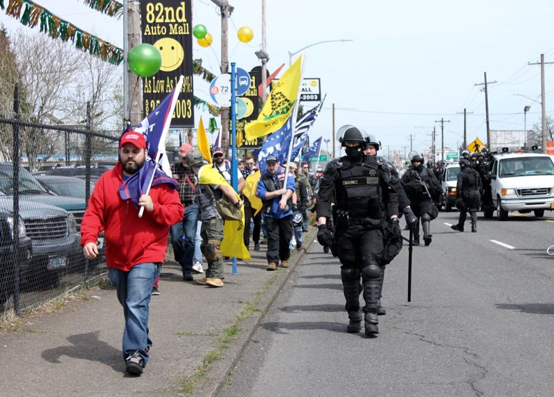 TRIBUNE PHOTO: LYNDSEY HEWITT - Right and left wing activists march down 82nd Avenue on Saturday.