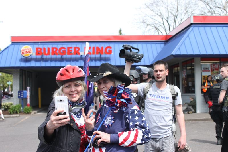 TRIBUNE PHOTO: LYNDSEY HEWITT - The march ended at Burger King along 82nd Avenue.