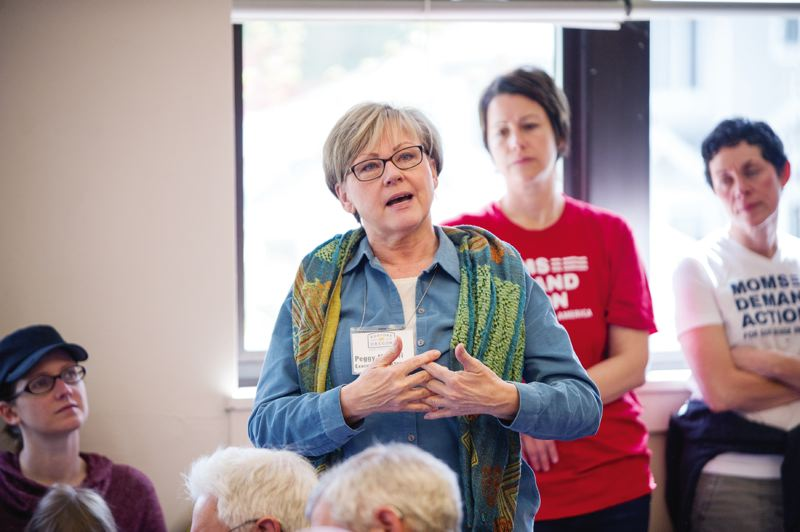 PORTLAND TRIBUNE: DIEGO G DIAZ  - About half the people who attended a legislative town hall on Saturday opposed a bill in Salem to increase residential densities, including Peggy Moretti, executive director of the Restore Oregon historic preservation organization.