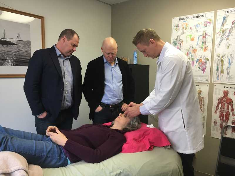 SUBMITTED PHOTO - Acupuncturist Brad Whisnant works with visiting acupuncturists from the St. Olav Clinic in Norway to conduct a successful eye clinic in St. Helens.