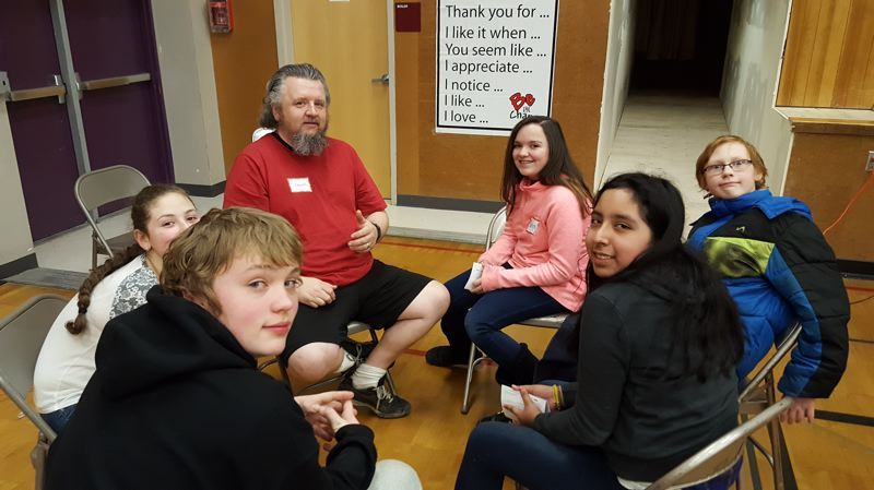 SUBMITTED PHOTO - Seventh-graders at Kraxberger Middle School participate in Challenge Day, an anti-bullying workshop funded by a grant from the Gladstone Education Foundation.