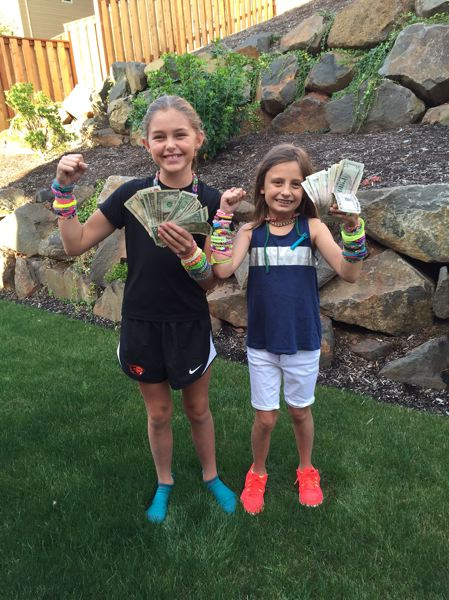 Madison Hauskins (left) and Hannah Erdmann's project raised $236, which was donated to Spring Mountain Elementary School.