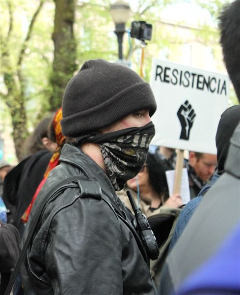 TRIBUNE PHOTO: LYNDSEY HEWITT - Many anarchists wore bandanas to conceal their identities.