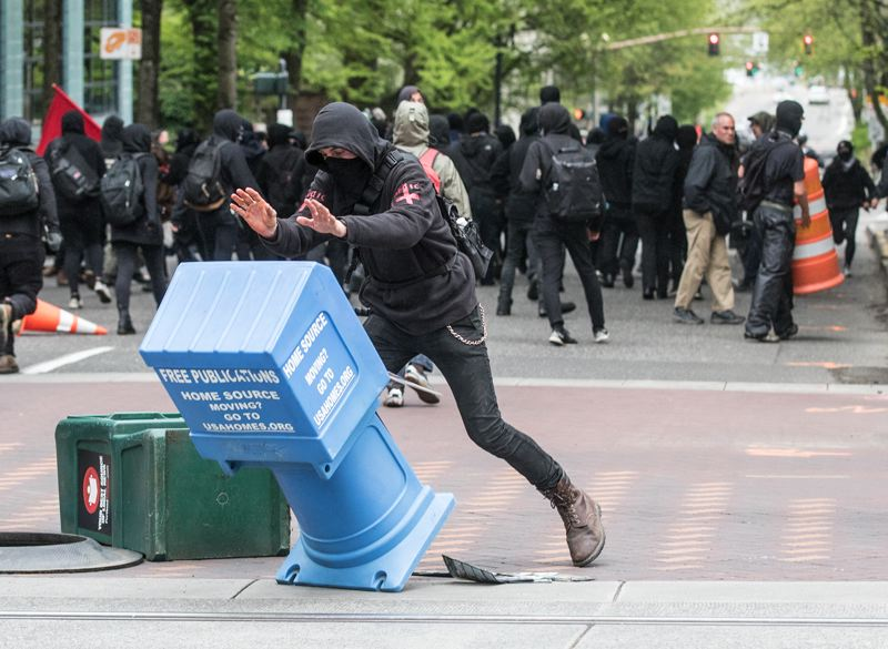 TRIBUNE PHOTO: JONATHAN HOUSE - Anarchists toppled news stands downtown.