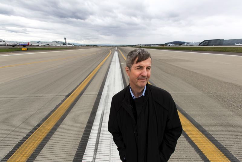 PAMPLIN MEDIA GROUP: JAIME VALDEZ - Bill Wyatt, Executive Director of the Port of Portland, stands in the middle of RWY 10R-28L, also referred as the south runway at the Portland International Airport, that airlines like Cathay Pacific, Hawaiian and Delta use.