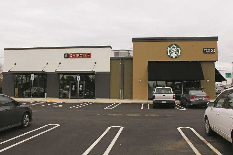 JULIA COMNES - The new location of Starbucks has opened at Woodburn Station, to be joined by Chipotle this Thursday.