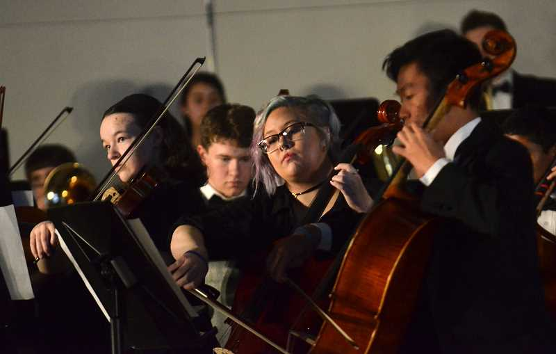 SPOKESMAN PHOTO: VERN UYETAKE - The Wilsonville High School orchestra was one of many student groups that performed during Springfest Friday, April 28.