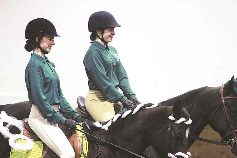 SUBMITTED PHOTO - Alexis Knight and Michaela Chapin in the working pairs competition. Knight and Chapin were the lone members of the team to qualify in all three of the Huskies' state-bound team events May 11-14 in Redmond.