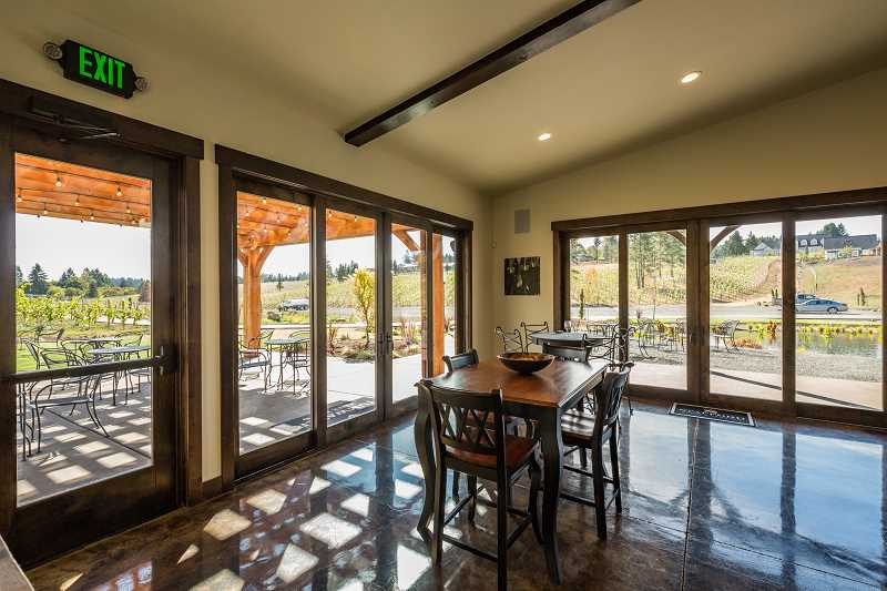The Barrel House is designed with sliding glass doors and garage doors which open onto patio space, extending the square footage during warm weather for parties and special events.