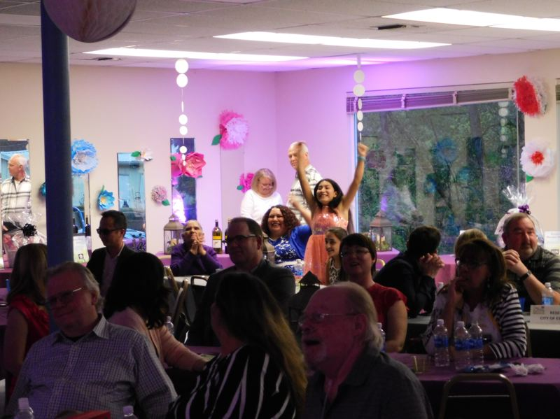 ESTACADA NEWS PHOTO: EMILY LINDSTRAND - Andrea Menchaca is triumphant after she and her mother Paulina win an item from the live auction at the Spring Gala on Saturday, April 29.