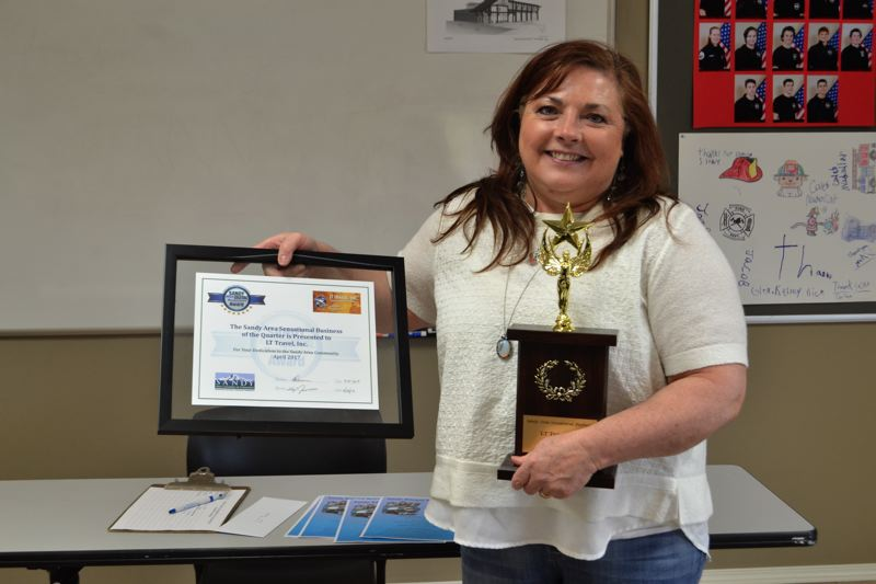 POST PHOTO: BRITTANY ALLEN - Lisa Foster received a trophy, framed certificate and a month of advertising with the chamber.