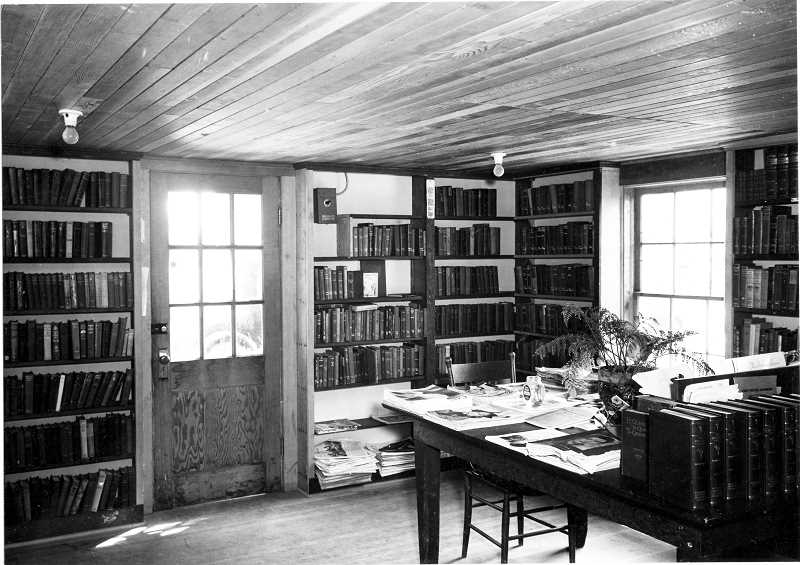 OSWEGO LOCAL HISTORY COLLECTION - The Molalla Public Library in about 1933. Magazines on the table include Radio Stars, Colliers and Ladies Home Journal.