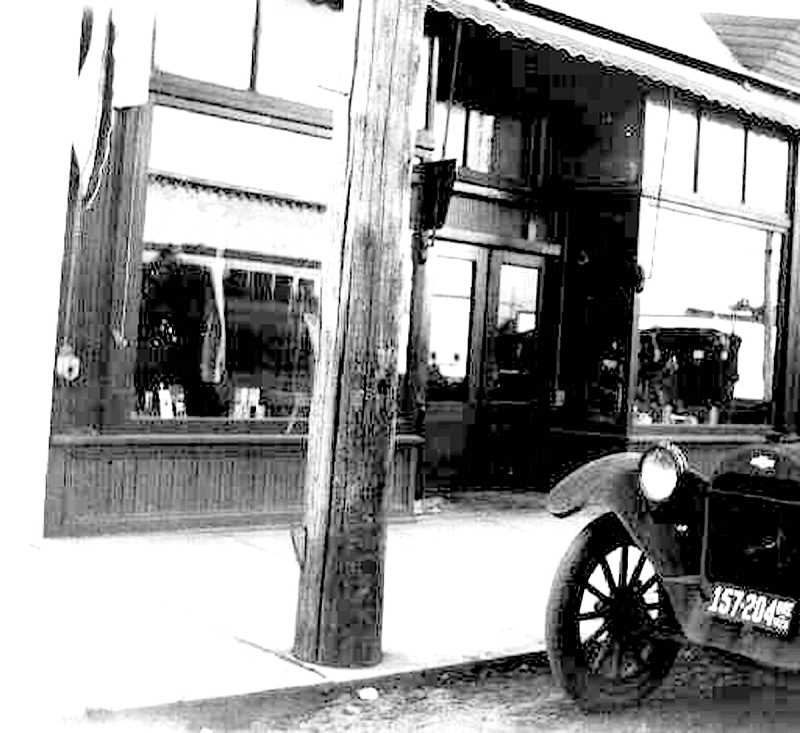 """PIONEER FILE PHOTO - William Mackrell's Harness Shop on South Molalla Avenue in about 1913, where Mr. Mackrell ran Molalla's first lending library, a """"reading room"""" and a collection of books. According to a Nov. 6, 1930 article in the Capital Journal,  he updated the collection by sending select books to Salem Library once every six months and receiving """"a completely new library."""""""