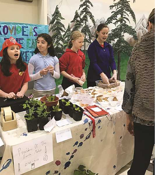 Students man a booth called Providers of the Earth Market