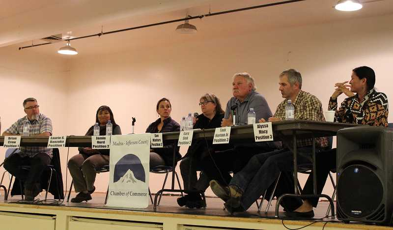HOLLY M. GILL - Seven candidates for three positions on the School District 509-J Board of Directors fielded questions from the audience at the Madras-Jefferson County Chamber of Commerce's forum April 26, in the Madras High School Commons. From left, the candidates include Brian Crow and incumbent Laurie Danzuka for positon 1; Jamie Hurd, Sue Matters and Gary Sisk for position 2; and incumbent Tom Norton Jr. and Alyssa Macy for position 3.