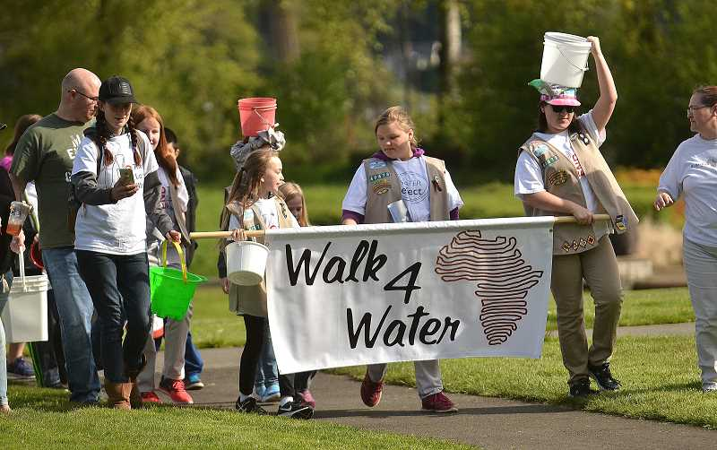 REVIEW PHOTO: VERN UYETAKE - Members of Girl Scout Troop 40473 lead off the Walk4Water in Lake Oswego on Saturday. This year's event put a special emphasis on involving children.