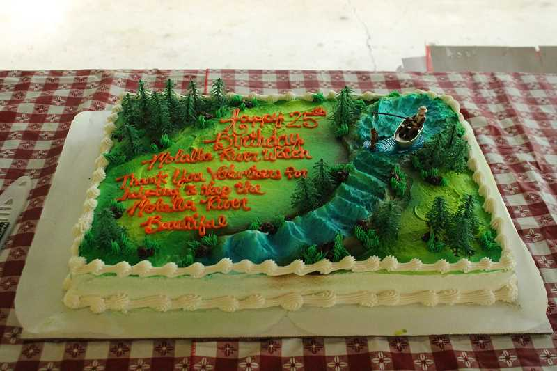 PIONEER PHOTO: CONNER WILLIAMS - A cake made to celebrate the 25th anniversary since Molalla River Watch's conception as a nonprofit organization.