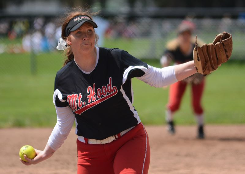 OUTLOOK PHOTO: DAVID BALL - Mt. Hood pitcher Sammie Byron winds up to make a throw during her complete-game effort in Saturdays 8-4 loss to Clackamas.