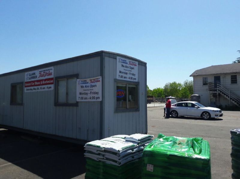 TIMES PHOTO: MARK MILLER - Clark Lumber & True Value Hardware has been operating out of a trailer in front of their former store since it burned down last July. Next month, the business will relocate to a site in Sherwood.