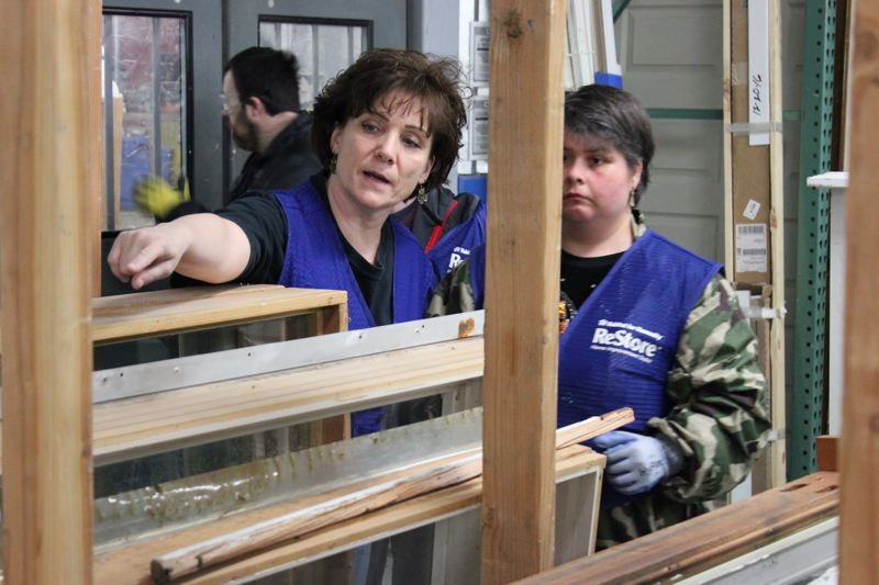 SUBMITTED PHOTO - Community Inclusion Specialist Linda Jones provides instructions to Emily Counts while helping out at the Habitat for Humanity ReStore in Portland.