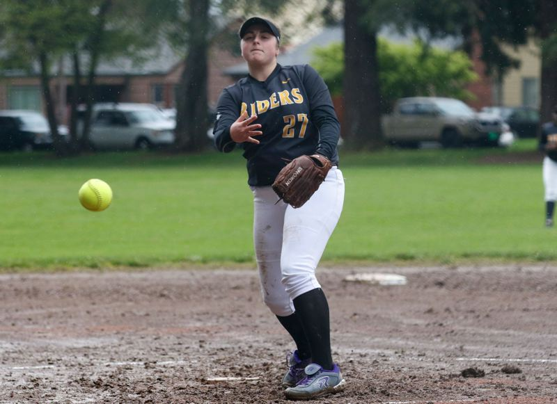 TRIBUNE PHOTO: JONATHAN HOUSE - Roosevelt High's Grace Ferres makes a pitch against Cleveland in the Roughriders' 4-2 victory last week at Woodstock Park.