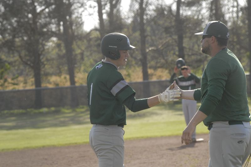 ESTACADA NEWS: MATT RAWLINGS - Estacada coach Andrew Higgins high-fives Sam Blankenship at third base