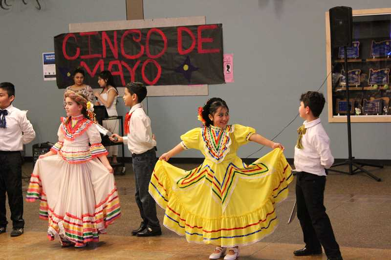 SPOKESMAN PHOTO: ANDREW KILSTROM - Baile Folklorico dancers put on a show for community members Thrusday, May 4 at Wilsonville High School.