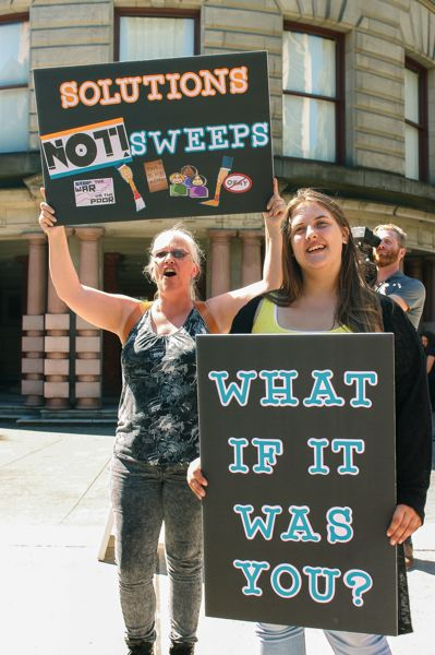PMG PHOTO - Danielle, right, joined community activists July 28, 2016, for a rally in front of Portland City Hall, calling for local rent control to help ease homelessness.