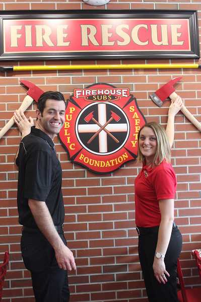 THE TIMES: MANDY FEDER-SAWYER - Brandon and Stephanie Ensley recently opened their third Firehouse Subs restaurant in three years. They plan to open five more in the next five years.