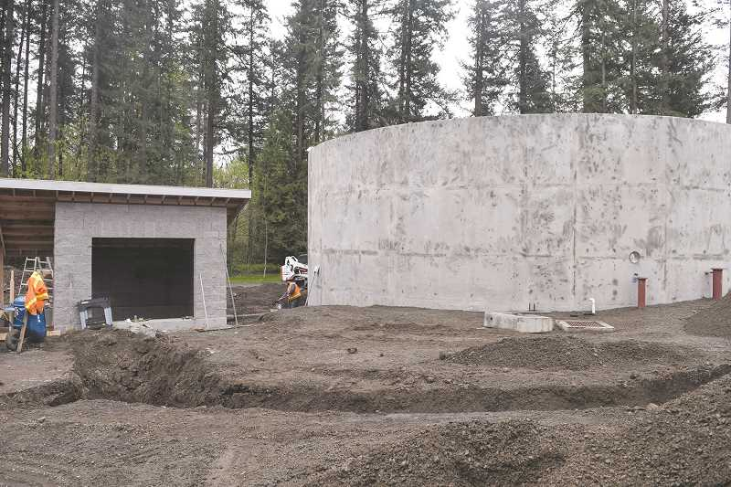 DANIEL PEARSON - The city of Canby's wastewater treatment plant is nearly completed with a $1.7 million, five-years upgrade tol its sewage treatment process. These two new storage tanks will store as much as 300,000 gallons.