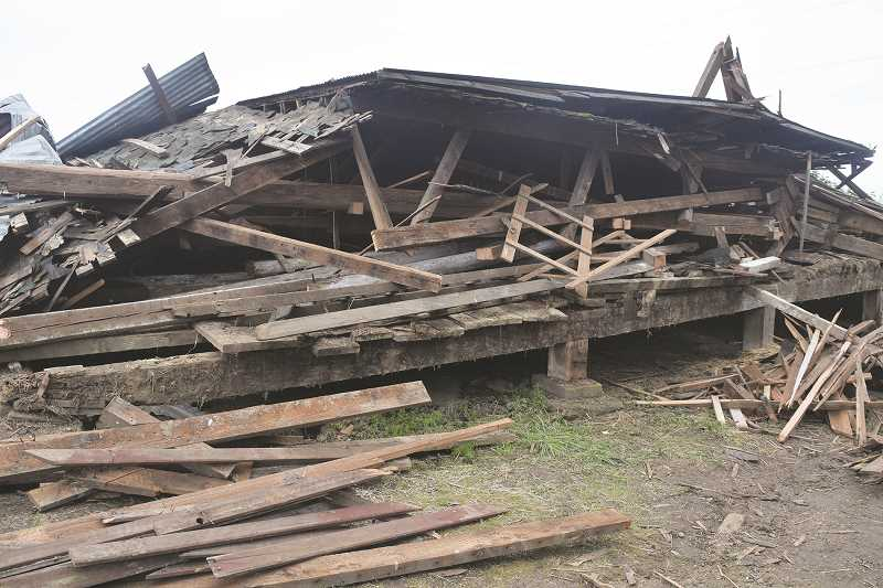 DANIEL PEARSON - One of the Canby area's most recognizable landmarks, The Gribble Barn, which stood on the same location just off Highway 170 about five miles south of the city limits, was torn down recently by the Gribble Family.