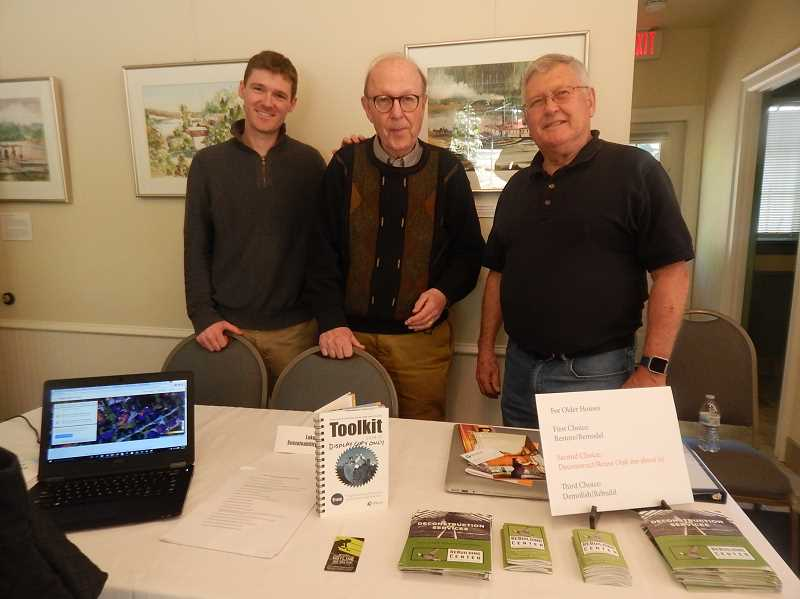 REVIEW PHOTO: ANTHONY MACUK - Sustainability Advisory Board members Eliot Metzger, Bob Sack and Richard Canaday hosted a table with information on eco-friendly renovations and deconstruction options for older homes.