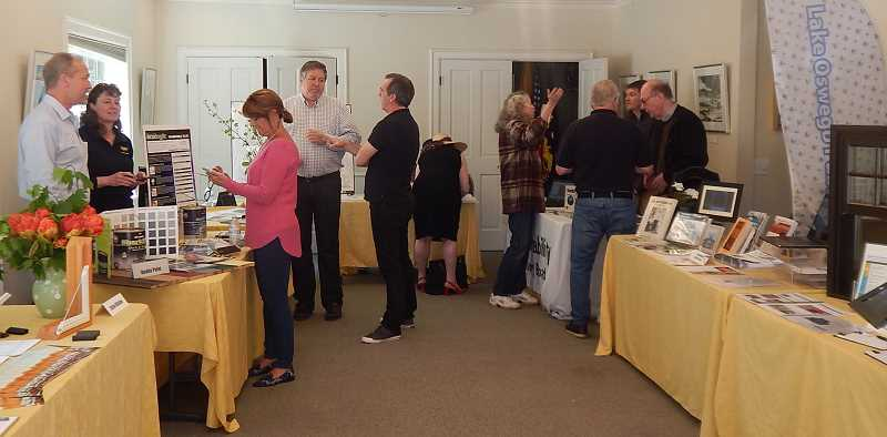 REVIEW PHOTO: ANTHONY MACUK - The four-hour Your House Matters Expo was held at the Oswego Heritage House, where visitors were free to walk in and talk to representatives from a half-dozen vendors and City groups about how to preserve their historic homes.