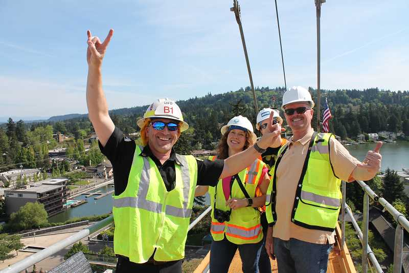 REVIEW PHOTO: ANTHONY MACUK - Lake Oswego Assistant Fire Chief Dave Morris was among the folks who made the climb Tuesday up a 171-foot-tall crane at the Wizer Block, along with City Plans Examiner Elizabeth Bunga, Assistant City Manager Megan Phelan and City Structural Inspector George Harper.