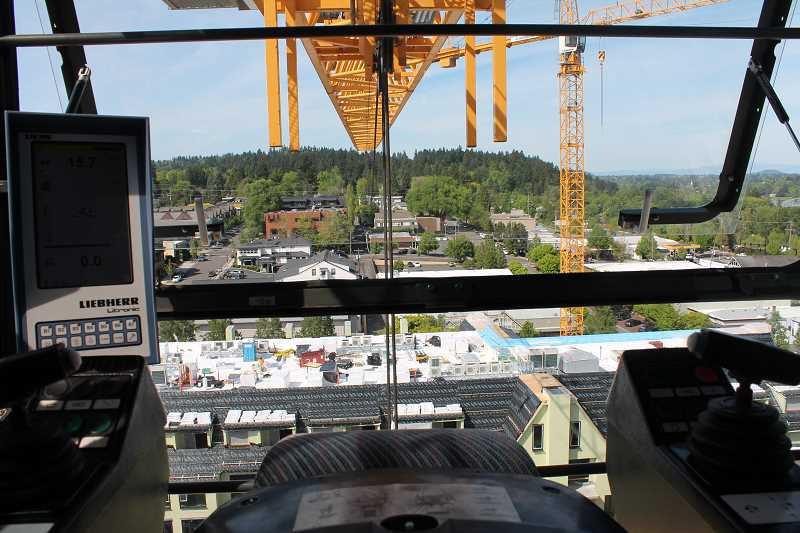 REVIEW PHOTO: ANTHONY MACUK - Heres the view from inside the crane operator's cab. Participants in Tuesday's ascent had to climb through the cab to reach the platform on top.