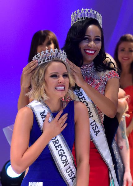 COURTESY: JERRY AND LOIS PHOTOGRAPH - Natriana Shorter, Miss Oregon USA 2016, in red gown, passes her crown to Elizabeth Denny, the new Miss Oregon USA 2017.