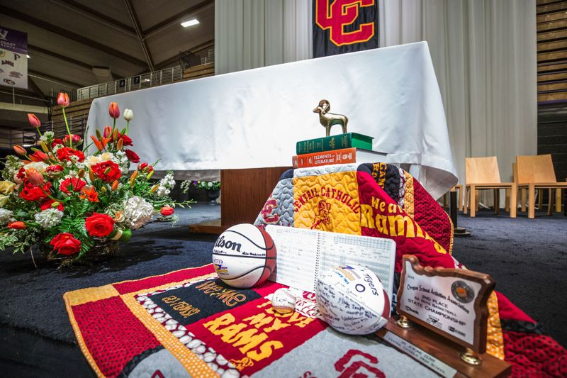 TRIBUNE PHOTO: JONATHAN HOUSE - Central Catholic High sports mementos sit at the altar during Sister Jerome Zerr's Memorial Mass on Monday at the University of Portland.
